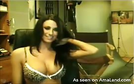 Voluptuous brunette flashes her big tits