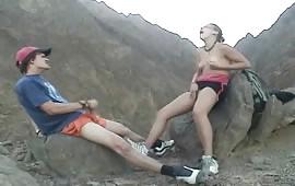 Horny couple in outdoor masturbation