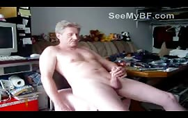 Mature gay dude masturbating his cock