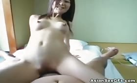 Asian rides a thick cock